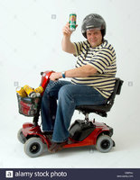 disabled-man-in-motorised-wheelchair-with-cans-of-lager-B39PAJ.jpg