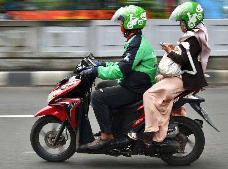 Grab moto driver and passenger