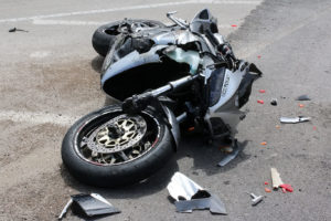 Traffic accident between a car and a motorcycle. Photo Credit: dolmanlaw.com