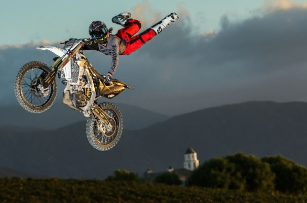Vicki Golden flies through the air during a freestyle motocross competition.  Photo credit: Wiseco