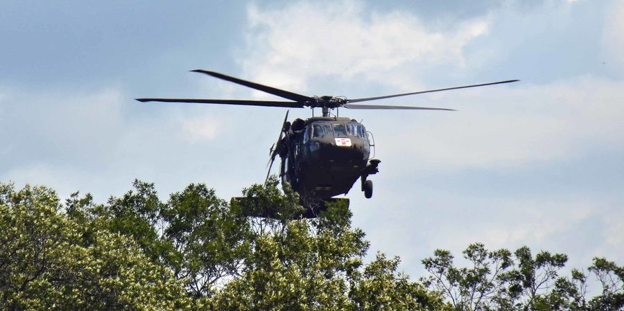 """At one point, a Blackhawk blew down a tree that blocked a trail."""