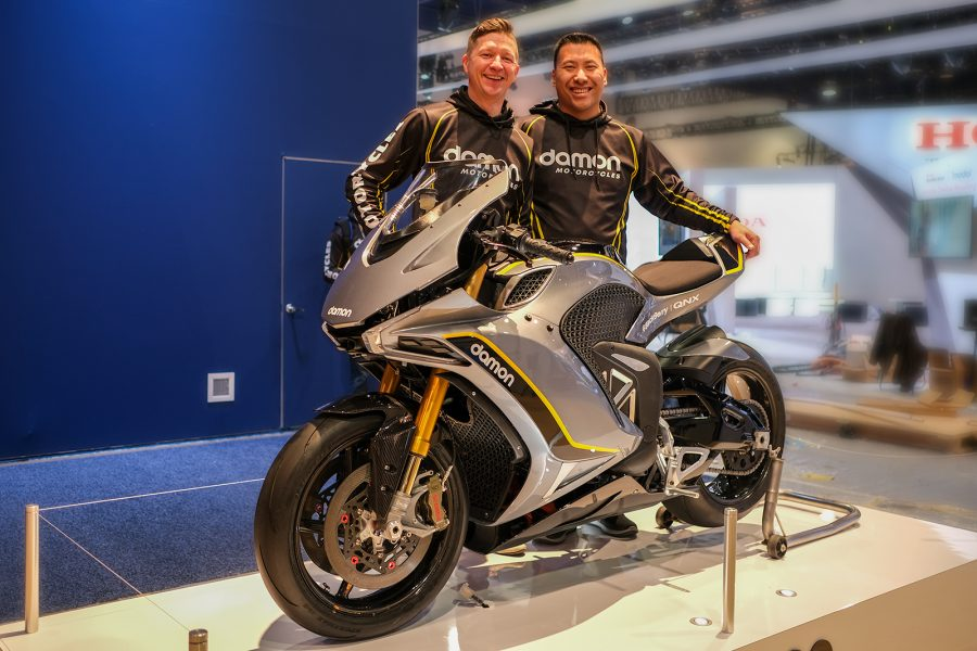 Damon's founders stand with the bike at CES. Photo: Damon