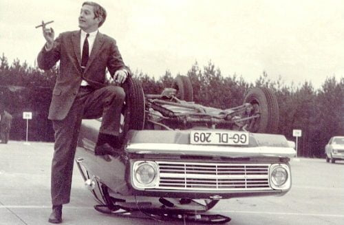 Bob Lutz with a car he had just rolled while he worked for General Motors.