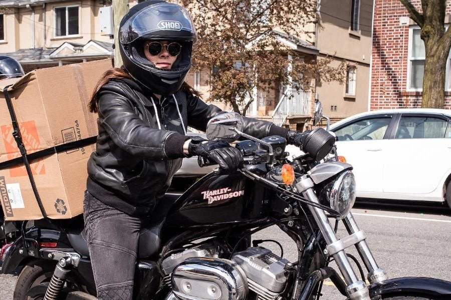 Know someone who's fighting COVID-19? Whether they're using their bike as a delivery tool, like this NYC rider, or doing something more low-key, REV'IT! wants to help recognize them. Photo: REV'IT!
