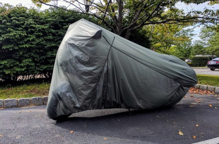 The Aerostich Ultralight bike cover, hiding a BMW K 1600 B. The cover folds into a pouch that is not much larger than my hand.